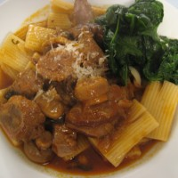 Rigatoni with Braised Lamb Shank Ragu & Sauteed Spinach