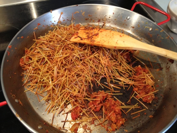 Add the toasted pasta to the browned tomato/onion/seasoning mixture