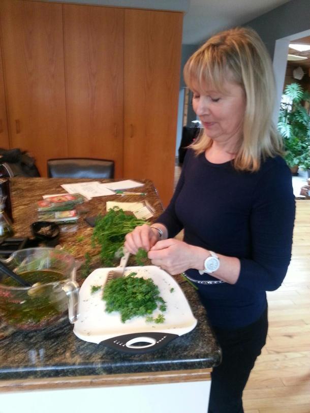 Basha preparing the herbs