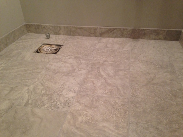 Powder Room floor with finished floor and grout. Florida Tile in Silverscreen and light grey grout