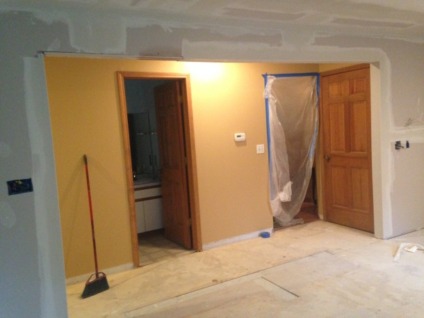 New Wall Opening for a Larger Kitchen Space. Notice Imprinting on the Floor Marking the Removed Wall
