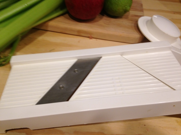A Mandolin Slicer set on the thinnest blade
