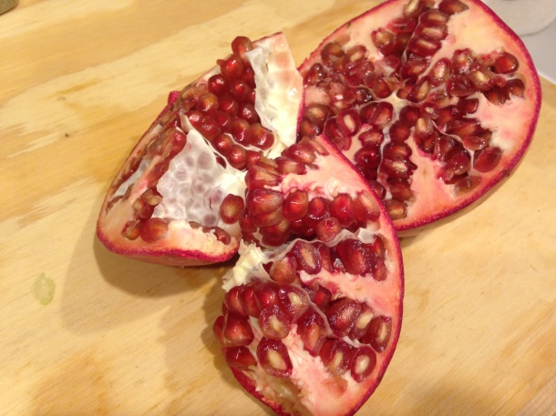 Pomegranate Sliced in Half and Then Broken into Quarters