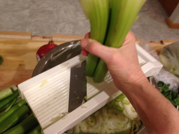 Slicing the celery 3 half stalks at a time