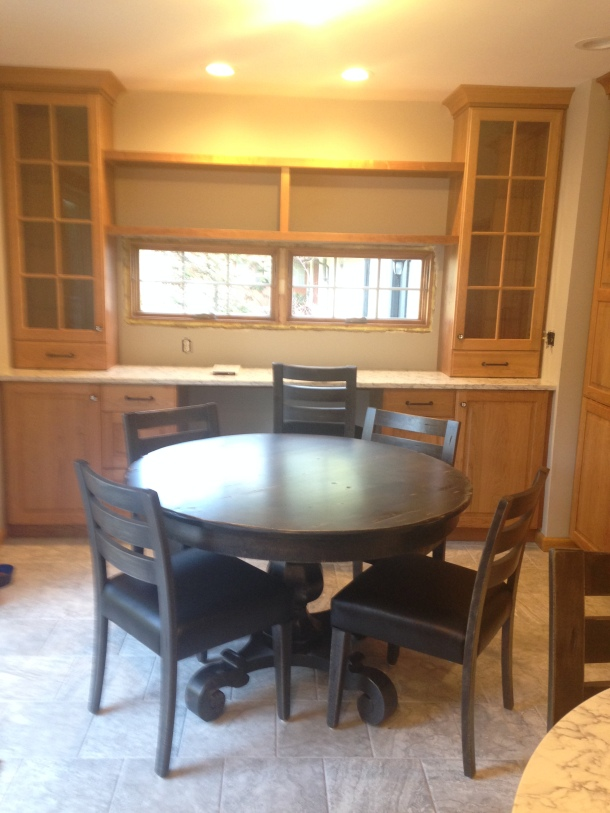Glass Cabinets Placed Over Quartz Counters; Distressed Table and Chairs Are In!