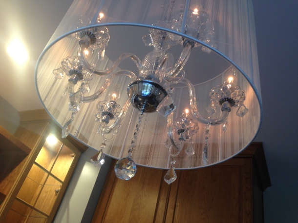 Crystal Chandelier Surrounded by a Sheer Drum
