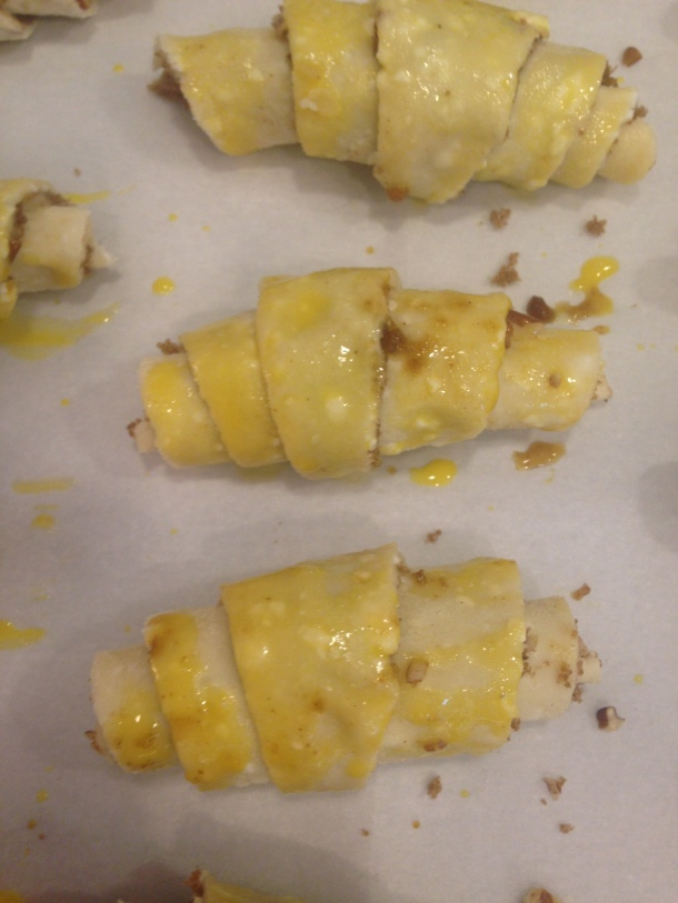 Brush Rugelach with egg yolk wash