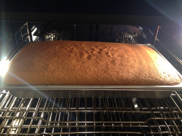Double size cake baking in oven