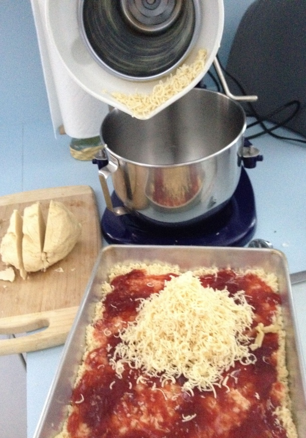 Grating the Dough Over the Strawberry Preserves